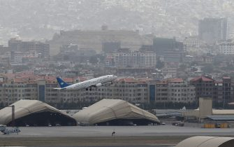 This picture taken on August 14, 2021 shows an Ariana Afghan Airlines aircraft taking-off from the airport in Kabul. (Photo by Wakil KOHSAR / AFP) (Photo by WAKIL KOHSAR/AFP via Getty Images)