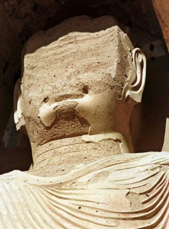 EDITORS NOTE: THIS IMAGE SHOWS PRIOR DAMAGE TO THE STATUE The damaged face of a 53-metre-high Buddha statue, chipped away by various Muslim rulers over past centuries, is seen in this December 18, 1997 file photograph in Bamiyan, central Afghanistan. The country's ruling Taliban have blown up the top quarter of this statue, a Pakistan-based Afghan news service reported March 9, 2001.   REUTERS/Muzammil Pasha/Files