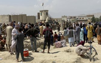 epa09417768 Afghans gather outside the Hamid Karzai International Airport to flee the country, after Taliban took control of Kabul, Afghanistan, 17 August 2021. Several people were reportedly killed at Kabul airport on 16 August as Afghans were attempting to hang on a moving US military plane leaving the airport. Taliban co-founder Abdul Ghani Baradar earlier in the day declared victory and an end to the decades-long war in Afghanistan, a day after the insurgents entered Kabul to take control of the country. Baradar, who heads the Taliban political office in Qatar, released a short video message after President Ashraf Ghani fled and conceded that the insurgents had won the 20-year war.  EPA/STRINGER