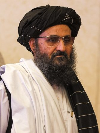 The leader of the Taliban negotiating team Mullah Abdul Ghani Baradar walks after the final declaration of the peace talks between the Afghan government and the Taliban in Qatar's capital Doha on July 18, 2021. - Representatives of the Afghan government and Taliban insurgents held talks in Doha as violence raged in their country with foreign forces almost entirely withdrawn. The two sides have been meeting on and off for months in the Qatari capital, but the talks have lost momentum as the insurgents made battlefield gains. (Photo by KARIM JAAFAR / AFP) (Photo by KARIM JAAFAR/AFP via Getty Images)