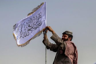 epaselect epa09417739 A Taliban fighter raises their flag on a vehicle as they patrol in Kandahar, Afghanistan, 17 August 2021. Taliban co-founder Abdul Ghani Baradar, on 16 August, declared victory and an end to the decades-long war in Afghanistan, a day after the insurgents entered Kabul to take control of the country. Baradar, who heads the Taliban political office in Qatar, released a short video message after President Ashraf Ghani fled and conceded that the insurgents had won the 20-year war.  EPA/STRINGER