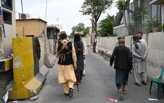Taliban fighters patrol along a road in Kabul on August 17, 2021, as the Taliban moved quickly to restart the Afghan capital following their stunning takeover of Kabul and told government staff to return to work. (Photo by WAKIL KOHSAR / AFP) (Photo by WAKIL KOHSAR/AFP via Getty Images)