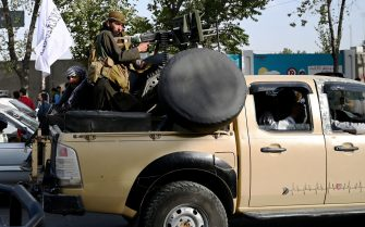Taliban fighters travel with weapons mounted on a vehicle in Kabul on August 19, 2021 after Taliban's military takeover of Afghanistan. (Photo by WAKIL KOHSAR / AFP) (Photo by WAKIL KOHSAR/AFP via Getty Images)