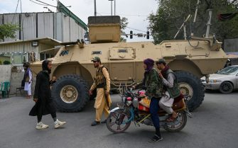 TOPSHOT - Taliban fighters patrol along a street in Kabul on August 17, 2021, as the Taliban moved to quickly restart the Afghan capital following their stunning takeover of Kabul and told government staff to return to work. (Photo by Wakil KOHSAR / AFP) (Photo by WAKIL KOHSAR/AFP via Getty Images)