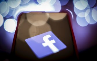The Facebook logo is seen on a mobile device screen in this photo illustration on January 31, 2019. (Photo by Jaap Arriens / Sipa USA)