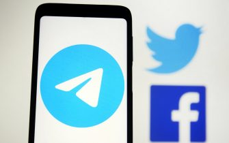 In this photo illustration, Telegram logo is seen displayed on a mobile phone screen in front of Facebook and Twitter logos. In the first week of January 2021, Telegram surpassed 500 million monthly active users, as the founder of Telegram Messenger Pavel Durov in your Telegram channel said on 12 January 2021, reportedly by media. - Pavlo Gonchar / SOPA Images//SOPAIMAGES_sopa014922/2101140938/Credit:SOPA Images/SIPA/2101140943