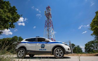 TA police car infront of the new towers equiped with zoom cameras, night vision cameras, thermal cameras and radar are feeding live image to the control room. Greece strengthens its surveillance capabilities to fight the increased refugee and migrants flows from Turkey. The border protection at Greek Turkish borders in Evros region is reinforced, supported by the EU, with more Frontex personnel and vehicles, more Greek border police officers, drones, building a new fence and wall, watchtowers with thermal remote cameras and radar on the tower, new combat vehicles and control rooms. On 20 August 2021 Greek ministers visited Evros to inspect the process of the steel fence works and the border surveillance systems against the new expected migrant crossing as EU is expecting a new asylum seeker wave from people from Afghanistan.  Evros Region, Greece on June 18, 2021 (Photo by Nicolas Economou/NurPhoto via Getty Images)