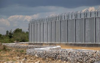 Greece is reinforcing the Greek Turkish borders with personnel, cameras, drones, heavy vehicles, FRONTEX officers but also with a 5 meter tall fence. The fence is actually a concrete filled, a construction for at least 40KM, a long coverage in the wetlands of Evros river (Meric in Turkish), Greece's river border with Turkey. EU is supporting the border fortification financially. Asylum seekers, migrants and refugees used Evros as an entrance point to Europe, while in March 2020 a huge wave of thousands of people tried to cross the borders. Poros Village, Evros region, Greece on June 18, 2021 (Photo by Nicolas Economou/NurPhoto via Getty Images)