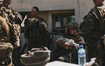 US soldiers calm infants during an evacuation at Hamid Karzai International Airport, Kabul, Afghanistan, on August 20, 2021, in the days following the fall of Kabul to Taliban movement, amid chaos and panic scenes at the capital's airport. Photo by CENTCOM-Balkis Press/ABACAPRESS.COM