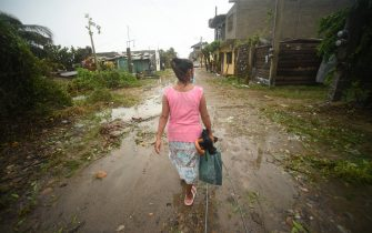 A resident walks past debris on a street after Hurricane Grace made landfall in Tecolitla, Veracruz state, Mexico, on Saturday, Aug. 21, 2021. Grace has weakened to a Category 1 hurricane after making landfall in Mexico earlier Saturday and is making its way across the center of the country. Photographer: Hector Adolfo Quintanar Perez/Bloomberg