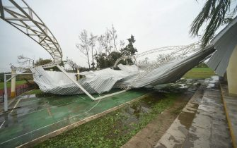 Debris from a building lays on a basketball court after Hurricane Grace made landfall in Tecolitla, Veracruz state, Mexico, on Saturday, Aug. 21, 2021. Grace has weakened to a Category 1 hurricane after making landfall in Mexico earlier Saturday and is making its way across the center of the country. Photographer: Hector Adolfo Quintanar Perez/Bloomberg