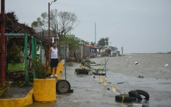 A resident surveys a flooded neighborhood after Hurricane Grace made landfall in Tecolitla, Veracruz state, Mexico, on Saturday, Aug. 21, 2021. Grace has weakened to a Category 1 hurricane after making landfall in Mexico earlier Saturday and is making its way across the center of the country. Photographer: Hector Adolfo Quintanar Perez/Bloomberg