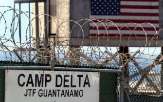 GUANTANAMO BAY, CUBA - APRIL 7:  The entrance to Camp Delta where detainees from the U.S. war in Afghanistan live is shown April 7, 2004 in Guantanamo Bay, Cuba. On April 20, the U.S. Supreme Court is expected to consider whether the detainees can ask U.S. courts to review their cases. Approximately 600 prisoners from the U.S. war in Afghanistan remain in detention.  (Photo by Joe Raedle/Getty Images)