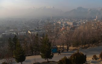 A man walks at the Wazir Akbar Khan hillside overlooking Kabul on February 22, 2020. - A week-long partial truce took hold across Afghanistan on February 22, with some jubilant civilians dancing in the streets as the war-weary country woke up to what is potentially a major turning point in its long conflict. (Photo by WAKIL KOHSAR / AFP) (Photo by WAKIL KOHSAR/AFP via Getty Images)