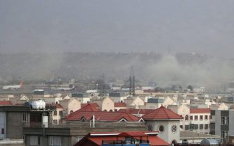 epa09430531 Smoke billows from the airport area after a blast outside the Hamid Karzai International Airport, in Kabul, Afghanistan, 26 August 2021. At least 13 people including children were killed in a blast outside the airport on 26 August. The blast occurred outside the Abbey Gate and follows recent security warnings of attacks ahead of the 31 August deadline for US troops withdrawal.  EPA/AKHTER GULFAM