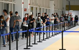 epa09307063 People queue up at night to be vaccinated against COVID-19 at Isabel Zendal Emergency Hospital in Madrid, Spain, early 28 June 2021. The hospital has started a 24 hour vaccine service to increase the daily vaccination rate.  EPA/Fernando Villar