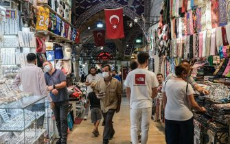 epa09408657 People wearing face masks at the historical Grand Bazaar, in Istanbul, Turkey, 10 August 2021. The global COVID-19 pandemic has dealt a major blow to Turkey's tourism industry last year. The relaxation of COVID-19 travel restrictions this summer gave hope for a recovery in Turkey's tourism industry, but forest fires have dealt a fresh blow to the sector, which accounts for about 5 percent of Turkey's economy.  EPA/SEDAT SUNA