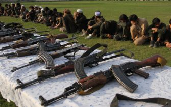Member of the Islamic state ISIS militants stand alongside their weapons, as they surrendered to government in Jalalabad, Nangarhar, Afghanistan on November 17, 2019. Around 225 Islamic state ISIS militants including 190 women and 208 children were surrendered to government during past two weeks, Afghan security forces lunched a military operation against ISIS in Achin district of Nangarhar province, Nangarhar governor Shamahmod miakhil said. Photo by: Wali_Sabawoon (Photo by Wali Sabawoon/NurPhoto via Getty Images)