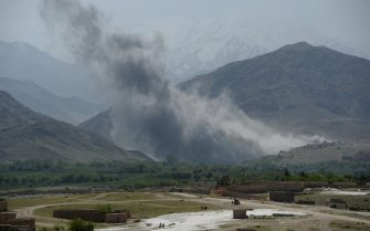In this photograph taken on April 11, 2017, smoke rises after an air strike by US aircraft on positions during an ongoing an operation against Islamic State (IS) militants in the Achin district of Afghanistan's Nangarhar province. An American special forces soldier has been killed while conducting operations against the Islamic State group in Afghanistan, the US military said.The US-backed Afghan military has vowed to wipe out the group in its strongholds in the eastern province of Nangarhar as IS challenges the more powerful Taliban on its own turf. / AFP PHOTO / NOORULLAH SHIRZADA        (Photo credit should read NOORULLAH SHIRZADA/AFP via Getty Images)