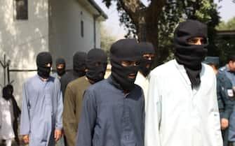 NANGARHAR, AFGHANISTAN - OCTOBER 3: 10 members of Daesh and 5 members of Taliban are seen unarmed as they captured by Afghan authorities in Nangarhar, Afghanistan on October 3, 2017.  (Photo by Zabihullah Ghazi/Anadolu Agency/Getty Images)