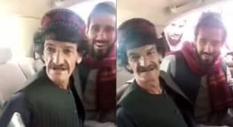 Cittadini afghani aspettano per entrare all'aeroporto