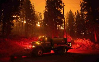 epa09437940 Firefighters prepare to fight the flames of the Caldor Fire in Meyers, California, USA, 30 August 2021. The fire, which has so far burned more than 177,000 acres, caused authorities to issue an evacuation order for residents of the city of South Lake Tahoe.  EPA/CHRISTIAN MONTERROSA