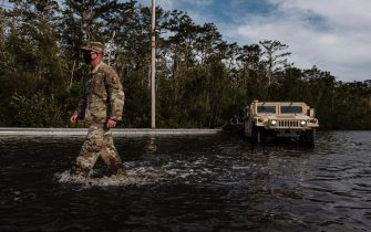 epa09437673 Louisiana National Guard assist in search and rescue missions related to flooding from Hurricane Ida in Jean Lafitte, Louisiana, USA, 30 August 2021. Hurricane Ida made landfall as a Category 4 storm bringing damaging winds and rain to southern Louisiana, knocking out power to the whole area and flooding neighborhoods.  EPA/DAN ANDERSON