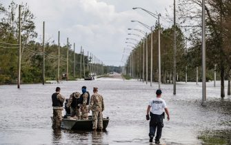epa09437675 Members of the Louisiana National Guard and local sheriffs department work on search and rescue missions related to flooding from Hurricane Ida in Jean Lafitte, Louisiana, USA, 30 August 2021. Hurricane Ida made landfall as a Category 4 storm bringing damaging winds and rain to southern Louisiana, knocking out power to the whole area and flooding neighborhoods.  EPA/DAN ANDERSON