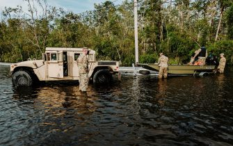 epa09437682 Members of the Louisiana National Guard assist in search and rescue missions related to flooding from Hurricane Ida in Jean Lafitte, Louisiana, USA, 30 August 2021. Hurricane Ida made landfall as a Category 4 storm bringing damaging winds and rain to southern Louisiana, knocking out power to the whole area and flooding neighborhoods.  EPA/DAN ANDERSON