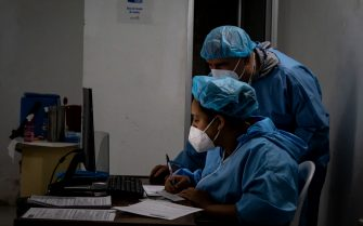 Medical nuses and medics fill forms of cencent after testing patients during the novel coronavirus (COVID-19) pandemic PCR testing in Hernan, Norte de Santander - Colombia on July 6, 2021.