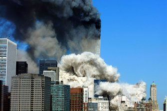 Smoke billows up after the first of the two towers of the World Trade Center collapses 11 September, 2001. Two planes were crashed into the twin towers of the center. Both towers have collapsed. Another plane was crashed into the Pentagon in Washington, DC. All are suspected terrorist attacks.   AFP PHOTO   Henny Ray ABRAMS (Photo credit should read HENNY RAY ABRAMS/AFP via Getty Images)