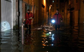 TOPSHOT - French firefighters inspect a flooded street after heavy rain in Agen, southwestern France on September 8, 2021. (Photo by Philippe LOPEZ / AFP) (Photo by PHILIPPE LOPEZ/AFP via Getty Images)