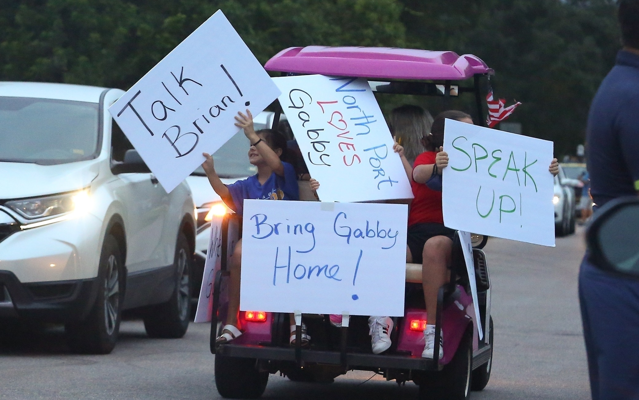 North Port, FL  - Resident of North Port, Florida come together to protest the recent disappearance of North Port resident, Gabby Petito. Protesters lined up outside of Brian Launderie's home with signs in support of Gabby Petito.  Pictured: Gabby Petito, Brian Laundrie   BACKGRID USA 17 SEPTEMBER 2021   BYLINE MUST READ: Maciel / BACKGRID  USA: +1 310 798 9111 / usasales@backgrid.com  UK: +44 208 344 2007 / uksales@backgrid.com  *UK Clients - Pictures Containing Children Please Pixelate Face Prior To Publication*