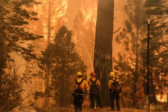 A firefighter attempts to control an active fire off Highway 50 during the Caldor Fire in Meyers, California, U.S., on Tuesday, Aug. 31, 2021. California's Caldor Fire moved closer to a popular alpine tourist destination in Northern California on Monday, prompting officials to order the evacuation of the resort town of South Lake Tahoe. Photographer: David Odisho/Bloomberg via Getty Images