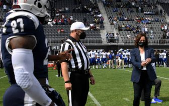US Vice President Kamala Harris (R) participates in the coin toss at the opening of the football game between Howard University and Hampton University at Audi Field in Washington, DC, on September 18, 2021. (Photo by Olivier DOULIERY / AFP) (Photo by OLIVIER DOULIERY/AFP via Getty Images)