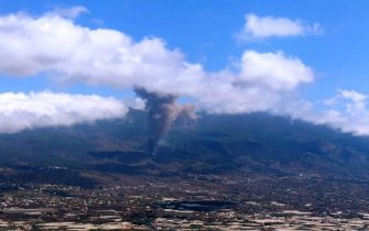 epa09476562 A handout photo made available by the Emergency Services 112 of the Canary islands shows smoke rising to the sky from the volcanic eruption in El Paso, La Palma, Canary islands, Spain, 19 September 2021. The area registered hundreds of small earthquakes along the week as magma pressed the subsoil on its way out. Regional authorities started to evacuate locals with mobility issues hours before the eruption took place.  EPA/HO Emergency Services 112 Canary HANDOUT   IMAGE TO BE USED ONLY IN RELATION TO THE STATED EVENT (MANDATORY CREDIT) HANDOUT EDITORIAL USE ONLY/NO SALES