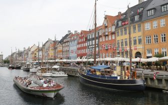 COPENHAGEN, DENMARK - JUNE 20, 2021: Boats on a canal in Nyhavn, a waterfront district of Copenhagen, in summer. Grigory Dukor/TASS (Photo by Grigory Dukor\TASS via Getty Images)