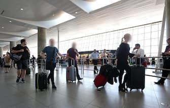 Travelers walk through International Terminal Four at John F. Kennedy International Airport in Queens, New York, USA, 30 June 2017. ANSA/PETER FOLEY