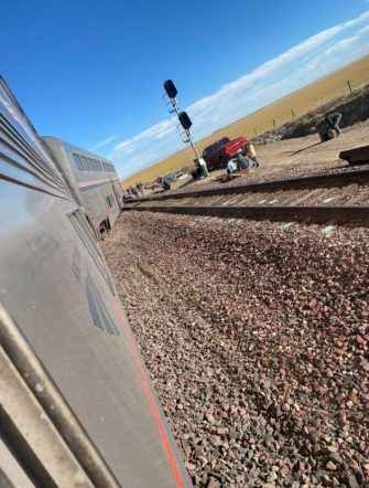 epa09488873 A view of a derailed Amtrak train, outside of Joplin, Montana, USA, 25 September 2021. According to a statement from Amtrak, the train was en route to Seattle after departing from Chicago, with 146 passengers and 16 crew members onboard. According to the Liberty County Sheriff's Department, three people died in the accident. The cause of the accident is not known at this time.  EPA/Jacob Cordeiro   EDITORIAL USE ONLY/NO SALES
