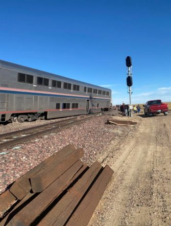 epa09488874 A view of a derailed Amtrak train, outside of Joplin, Montana, USA, 25 September 2021. According to a statement from Amtrak, the train was en route to Seattle after departing from Chicago, with 146 passengers and 16 crew members onboard. According to the Liberty County Sheriff's Department, three people died in the accident. The cause of the accident is not known at this time.  EPA/Jacob Cordeiro   EDITORIAL USE ONLY/NO SALES