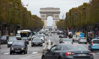 """People drive their cars on the avenue des Champs-Elysee leading to the Arch of Triumph in Paris, France on October 30, 2020. The traffic looks almost as usual despite a second lockdown came into force at midnight on Friday (23:00 GMT) to tackle spiralling Covid infections. People have been ordered to stay at home except for essential work or medical reasons. President Emmanuel Macron said the country risked being """"overwhelmed by a second wave that no doubt will be harder than the first"""". Photo by Raphael Lafargue/ABACAPRESS.COM"""