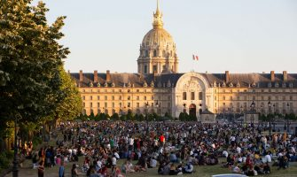 People sit and enjoy the sun and picnic on the garden of the Esplanade des Invalides in Paris on May 30, 2020, on the first day of reopening following the nationwide lockdown put into place on March 17, to stop the spread of the novel corona virus COVID-19 pandemic. Photo by Raphael Lafargue/ABACAPRESS.COM