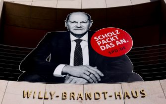 epa09410761 A large scale election poster of Social Democratic Party (SPD) top candidate for the federal elections, Olaf Scholz, is seen on the facade of the Willy-Brandt-Haus, headquarters of the German Social Democrtic Party (SPD) in Berlin, Germany, 12 August 2021. The federal German elections will be held on 26 September 2021.  EPA/FILIP SINGER