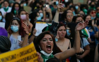 SANTIAGO, CHILE - SEPTEMBER 28: Chilean women celebrate after the Chilean Chamber of Deputies passed abortion bill on September 28, 2021 in Santiago, Chile. Chile's lower house of Congress approved today the bill to decriminalize abortion within the first 14 weeks of pregnancy, an initiative that must now be voted on in the Senate.  (Photo by Marcelo Hernandez/Getty Images)