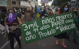 People take part in a demonstration demanding the decriminalization of abortion during the Global Day of Action for Legal and Safe Abortion in Latin America and the Caribbean, in Quito on September 28, 2021. (Photo by RODRIGO BUENDIA / AFP) (Photo by RODRIGO BUENDIA/AFP via Getty Images)