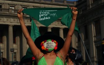 LIMA, PERU - 2021/09/28: A girl waving a green scarf as dozens of women, wearing green scarves, carry out a demonstration in front of the Peruvian Judiciary Palace demanding the legalization of abortion. Abortion in Peru, a conservative country, is illegal and punishable. (Photo by Carlos Garcia Granthon/Fotoholica Press/LightRocket via Getty Images)