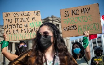 People protest demanding the decriminalization of abortion during the Global Day of Action for Legal and Safe Abortion in Latin America and the Caribbean, outside the Justice Palace in Lima, on September 28, 2021. (Photo by ERNESTO BENAVIDES / AFP) (Photo by ERNESTO BENAVIDES/AFP via Getty Images)