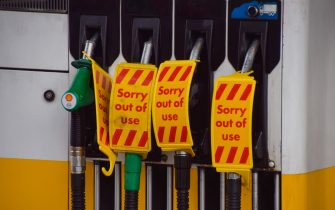 LONDON, UNITED KINGDOM - 2021/09/30: 'Sorry Out Of Use' signs cover petrol pumps at a Shell station in Islington which ran out of fuel after reopening for just one day.  Many stations have run out of petrol due to a shortage of truck drivers linked to Brexit, along with panic buying. (Photo by Vuk Valcic/SOPA Images/LightRocket via Getty Images)