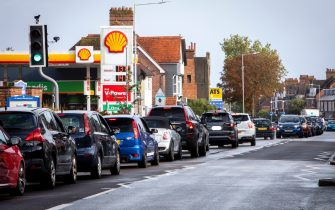 As the fuel crisis in the UK continues, this Shell petrol station is open for business as usual, motorists arrive in with their cars to fill up with fuel on the 1st of October 2021 in Folkestone, United Kingdom. Almost all the petrol stations in Folkestone have no fuel, this Shell garage took a delivery recently and now has queues over half a mile in both directions. People have been waiting for more than 2 hours to get fuel. Panic buying and long queues outside some petrol stations as the crisis, which has been caused by a lack of HGV drivers available to deliver supplies, continues. (photo by Andrew Aitchison / In pictures via Getty Images)