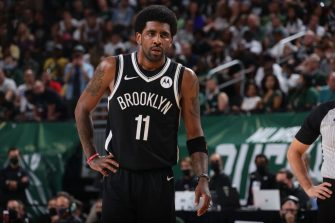 MILWAUKEE, WI - JUNE 13: Kyrie Irving #11 of the Brooklyn Nets looks on during Round 2, Game 4 of the 2021 NBA Playoffs on June 13 2021 at the Fiserv Forum Center in Milwaukee, Wisconsin. NOTE TO USER: User expressly acknowledges and agrees that, by downloading and or using this Photograph, user is consenting to the terms and conditions of the Getty Images License Agreement. Mandatory Copyright Notice: Copyright 2021 NBAE (Photo by Nathaniel S. Butler/NBAE via Getty Images).